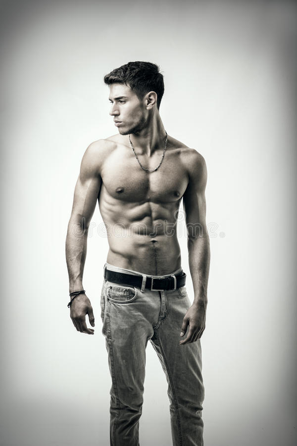 Handsome shirtless athletic young man on white royalty free stock images