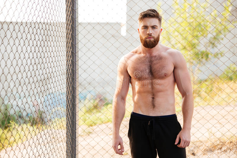 Handsome shirtless fitness man during workout outdoors stock photos