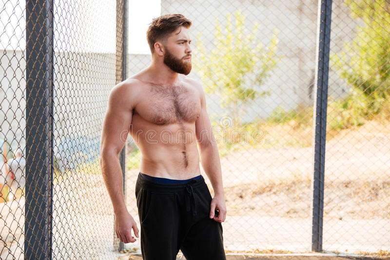 Handsome shirtless fitness man during workout outdoors stock photography