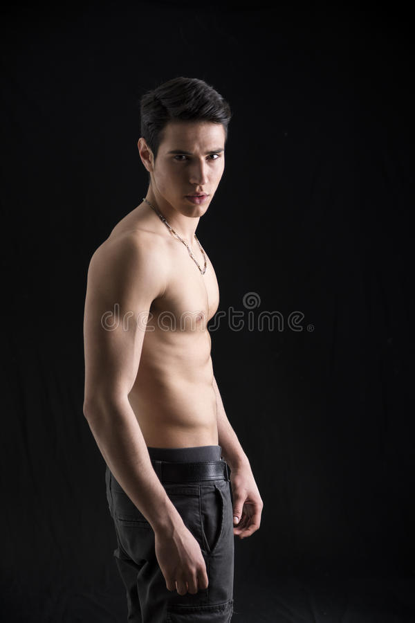 Handsome shirtless muscular young man's profile royalty free stock images