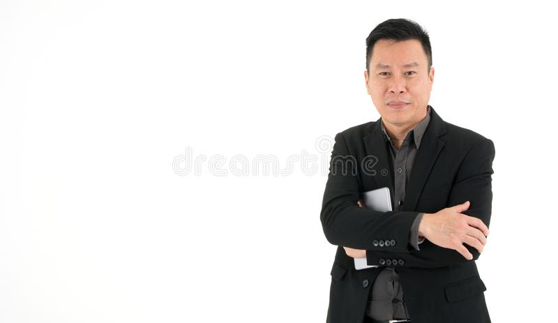 Handsome smiling business man in suit holding mobile device, isolated on white background royalty free stock images