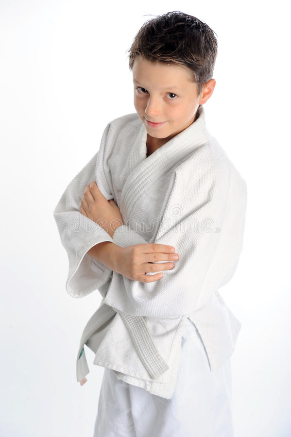 Handsome smiling karate boy. Confident handsome little karate boy portrait royalty free stock images