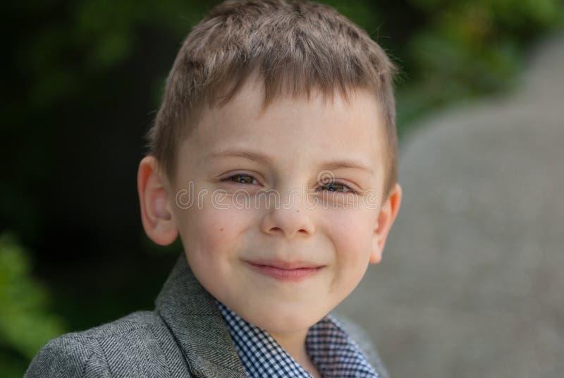 Handsome smiling little boy stock image