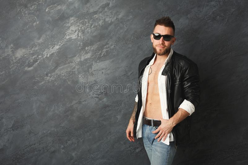 Handsome smiling man posing in studio stock photos