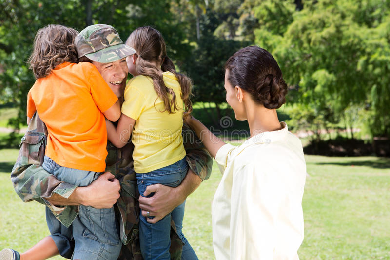 Handsome soldier reunited with family royalty free stock photo
