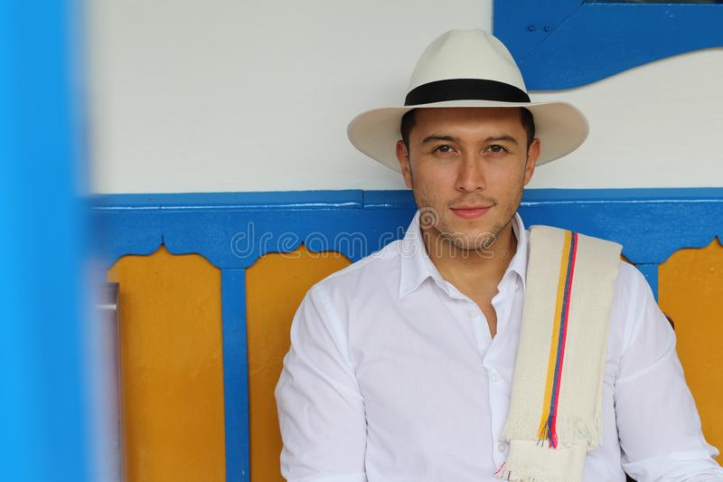Handsome South American man wearing hat royalty free stock photography