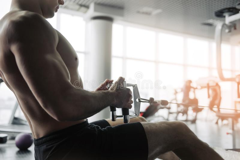 Handsome strong athletic men pumping up muscles workout bodybuilding concept background - muscular bodybuilder handsome men doing royalty free stock photo