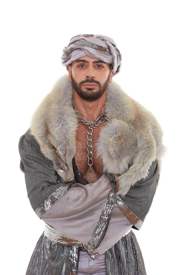 Man in oriental costume. Handsome strong courageous man in oriental costume stands on a white background royalty free stock image