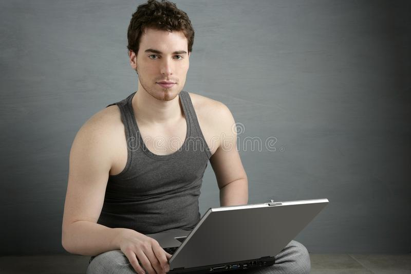 Handsome student young man sit working laptop royalty free stock photography