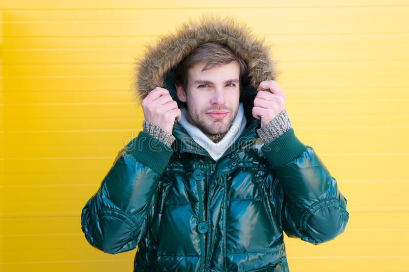 Handsome style. Fashionable man in cold weather style. Fashion model enjoying warmth and comfort. Casual fashion coat. For cold winter conditions. Handsome man stock photography