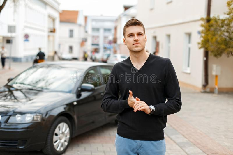Handsome stylish businessman in a black T-shirt stock image