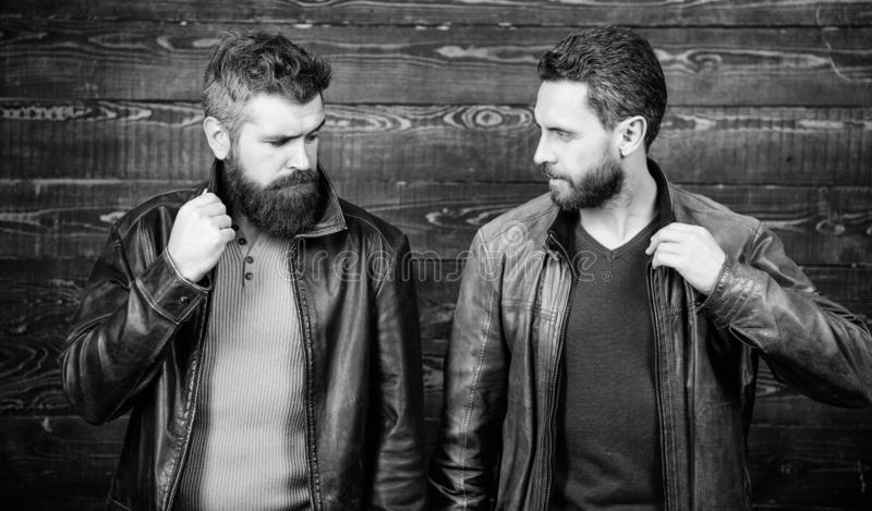 Handsome stylish and cool. Feel confident in brutal leather clothes. Brutal men wear leather jackets. Leather fashion. Menswear. Men brutal bearded hipster royalty free stock photos