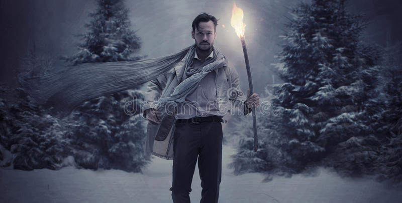 Handsome stylish guy wholding torch. Handsome stylish man holding torch stock photo