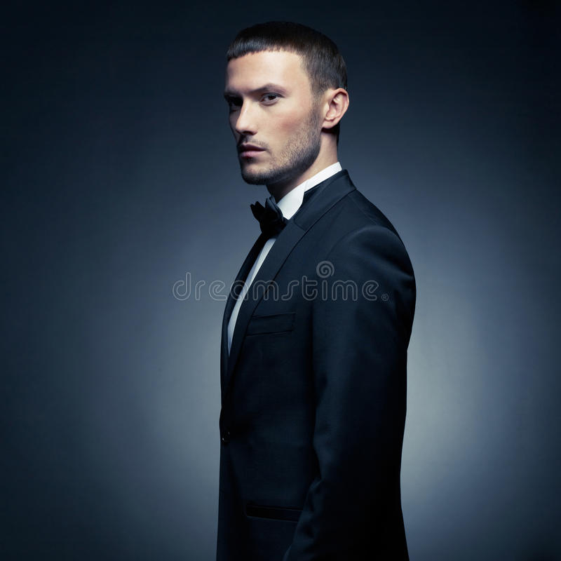 Handsome stylish man. Portrait of handsome stylish man in elegant black suit stock image