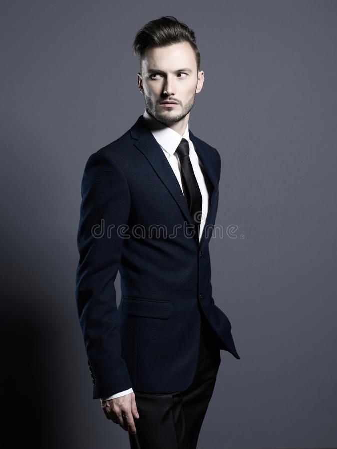 Handsome stylish man in elegant suit stock photo