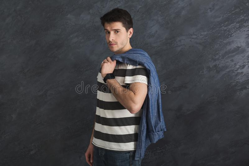 Handsome stylish man posing in studio stock photography