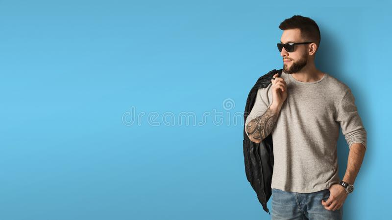 Handsome stylish man posing in studio stock images