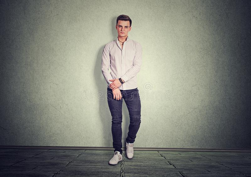 Handsome stylish man in shirt and denim stock photos