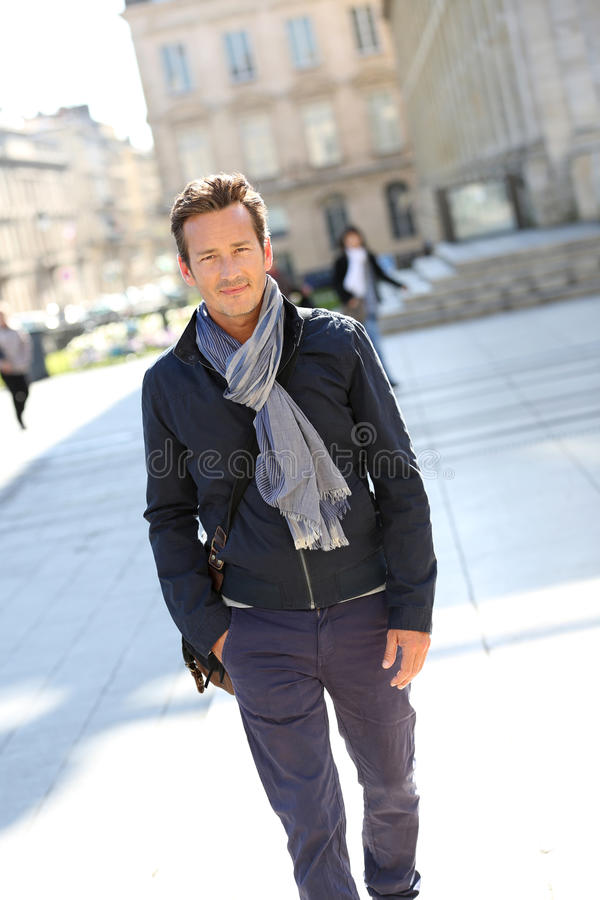 Handsome stylish man walking in town royalty free stock images