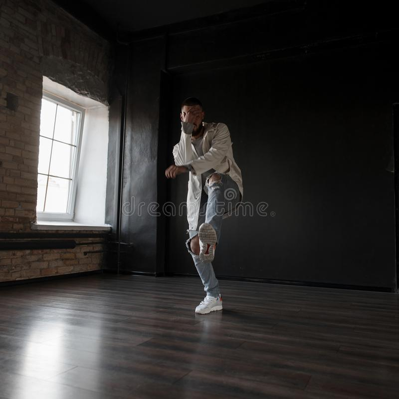 Handsome stylish young man dancer in fashion clothes stock photos