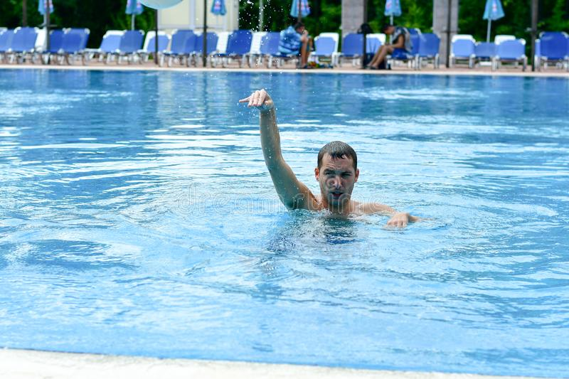 Man in a pool stock photos