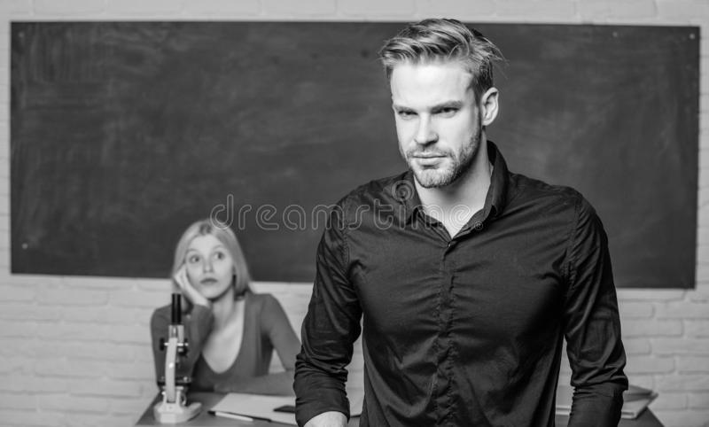 Handsome teacher. School and college education. Successfully graduated. Youth mentoring. Man well groomed attractive. Teacher in front of classroom. Obsessed royalty free stock photos