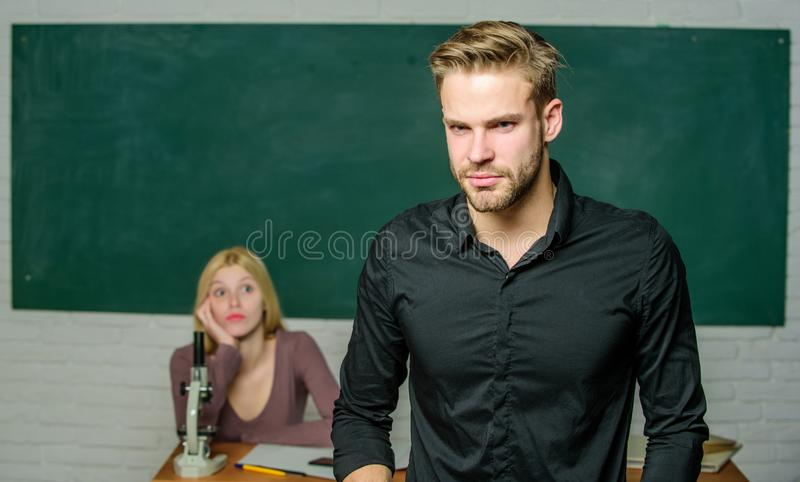 Handsome teacher. School and college education. Successfully graduated. Youth mentoring. Man well groomed attractive. Teacher in front of classroom. Obsessed stock photo