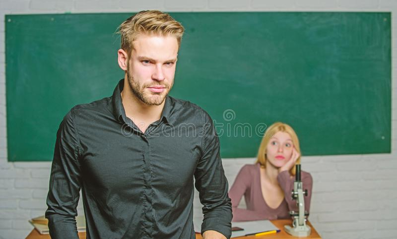 Handsome teacher. School and college education. Successfully graduated. Youth mentoring. Man well groomed attractive. Teacher in front of classroom. Obsessed royalty free stock images