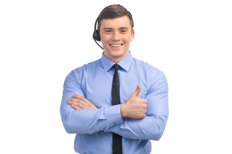 Handsome technical support operator working on white. stock image