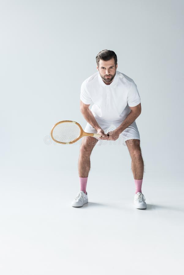 handsome tennis player with tennis racket stock images