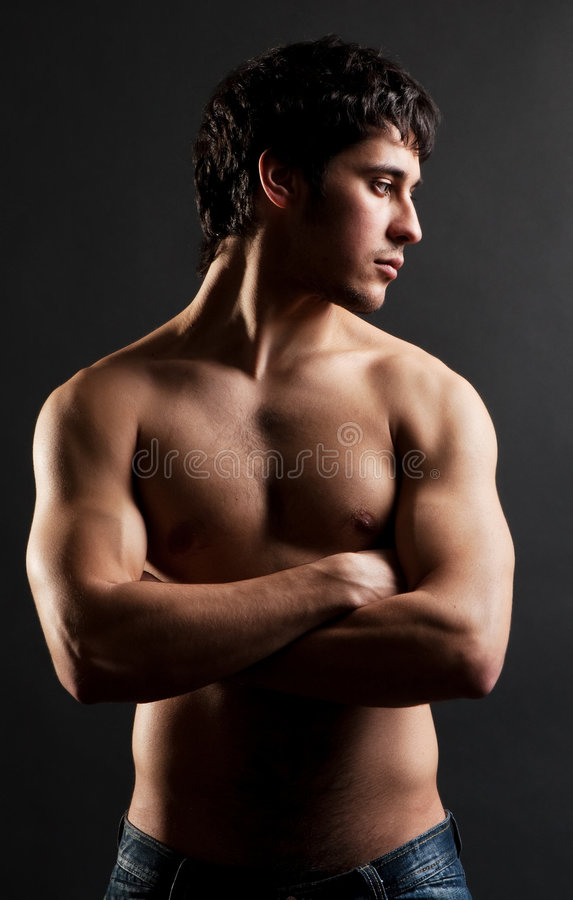 Handsome thoughtful man with naked torso stock photography