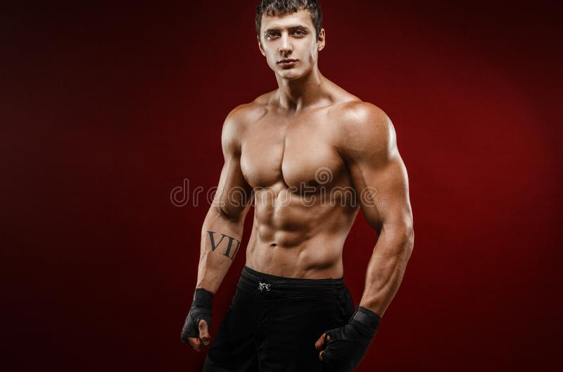 Handsome topless muscular man in fighting gloves royalty free stock image