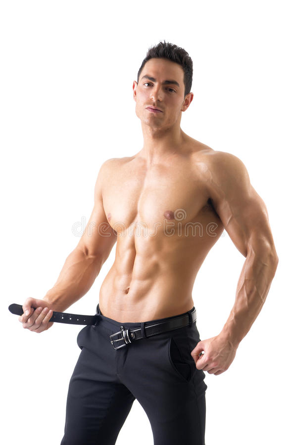 Handsome topless muscular man undressing, isolated stock image