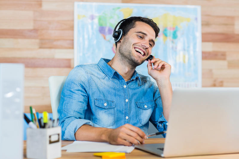 Handsome travel agent speaking with customer. In the office stock images