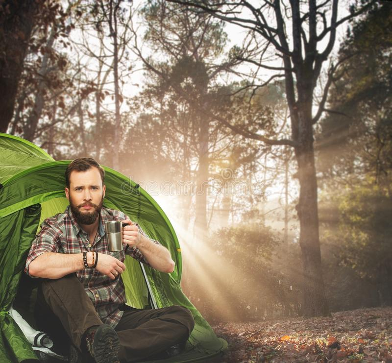 Handsome traveler near tent royalty free stock photo