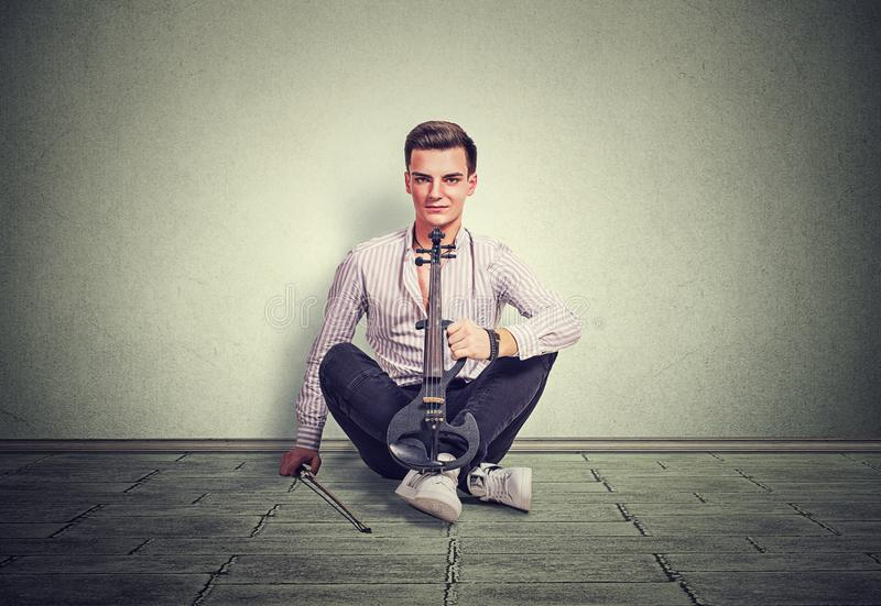 Modern young man with violin royalty free stock image