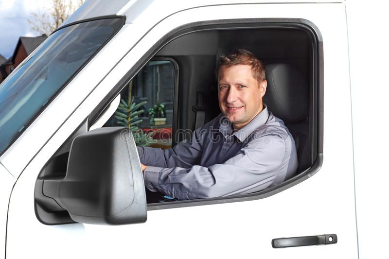 Handsome truck driver. Smiling truck driver in the car. Delivery cargo service stock images