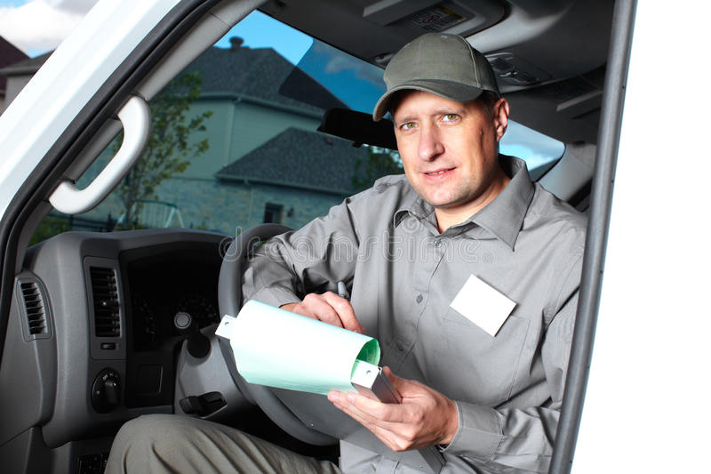 Handsome truck driver. Smiling truck driver in the car. Delivery cargo service royalty free stock photo