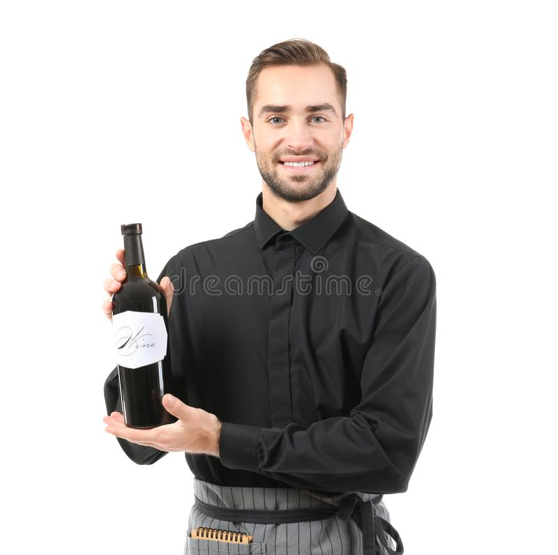 Handsome waiter with bottle of wine stock photos