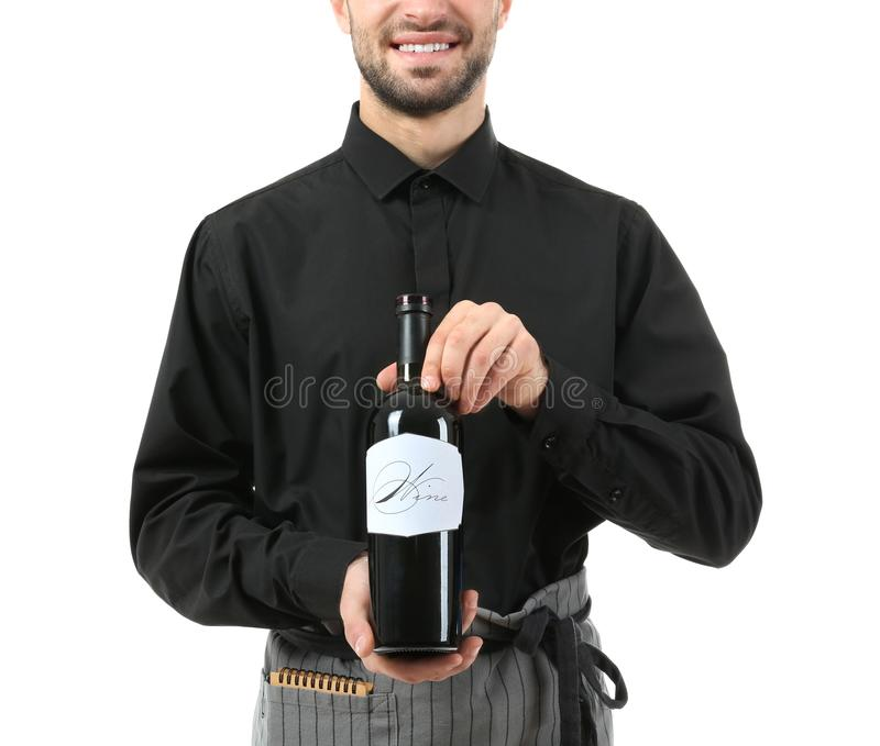 Handsome waiter with bottle of wine on white background stock photos