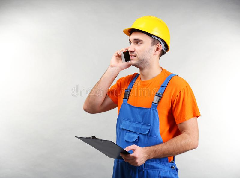 Handsome warehouse worker talking by mobile phone stock photo