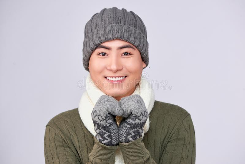 Handsome winter asian man in knitted woolen clothing hat stock images