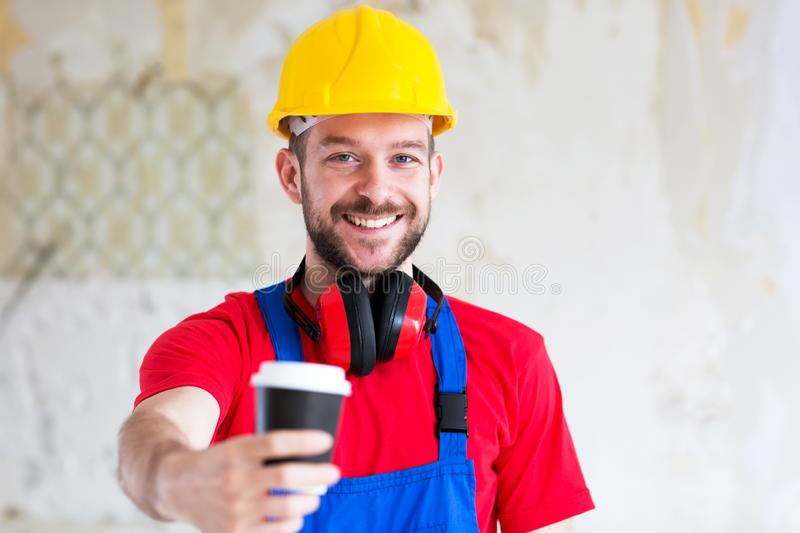 Handsome worker taking a coffee break stock images