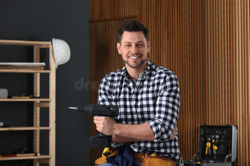 Handsome working man with electric screwdriver . Home repair royalty free stock photos