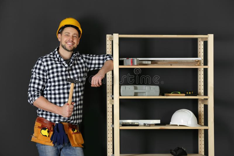 Handsome working man in hard hat with hammer. Home repair royalty free stock photo