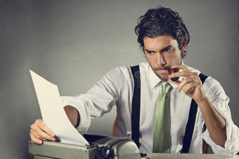 Handsome writer with pipe stock photography