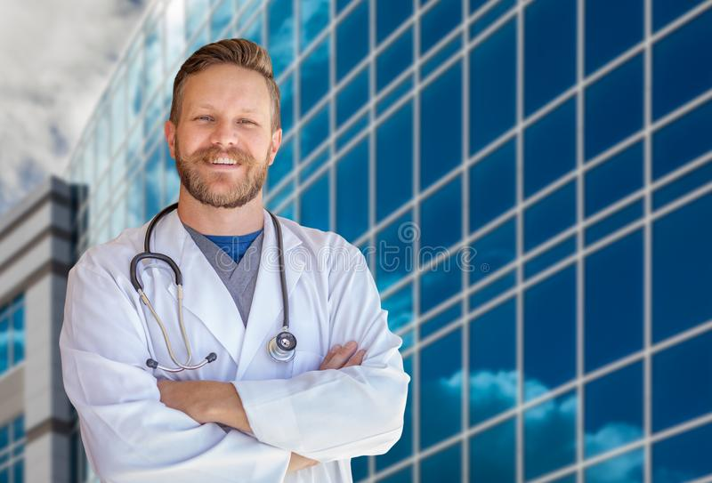 Handsome Young Adult Male Doctor With Beard In Front of Hospital royalty free stock image