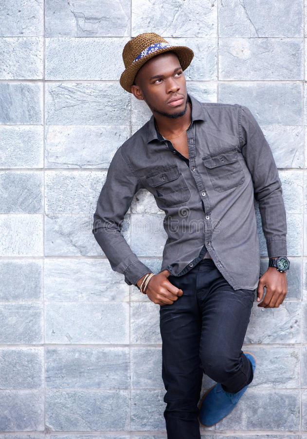 Handsome young african american man leaning against wall stock photos