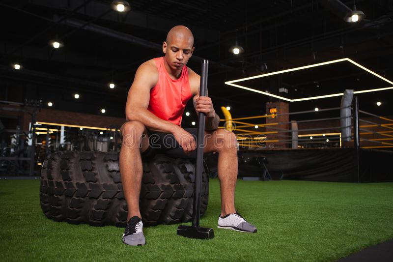 Handsome male African athlete working out at the gym stock images