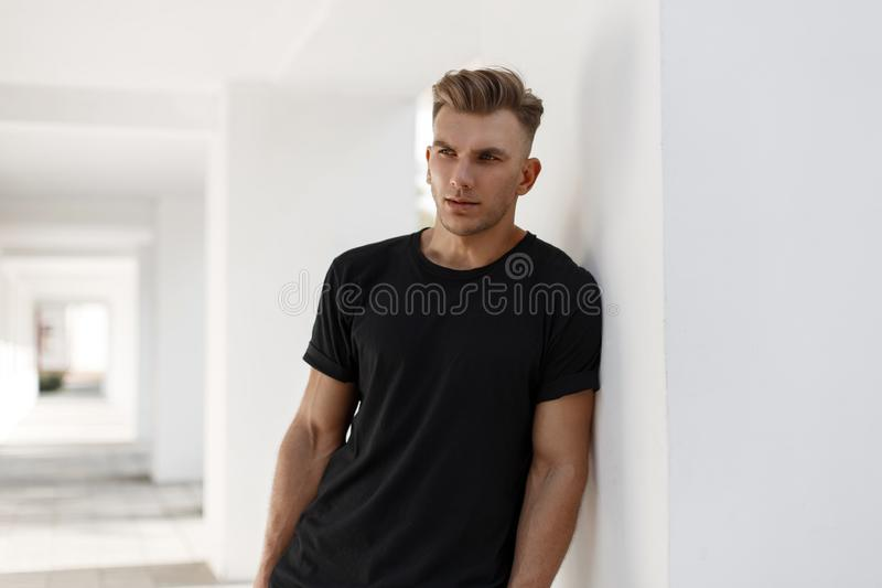 Handsome young american stylish man with hairstyle stock image
